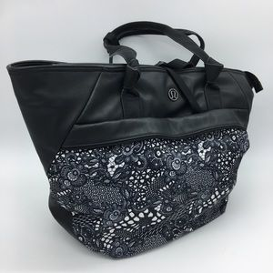 Lululemon black and navy overnight bag